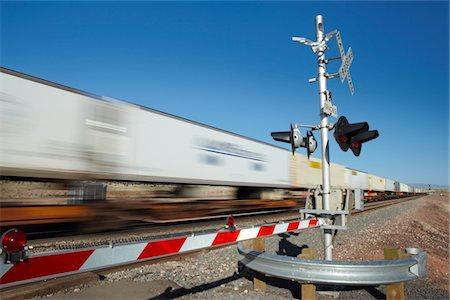 Train passing level crossing, motion blur Stock Photo - Premium Royalty-Free, Code: 693-03317575