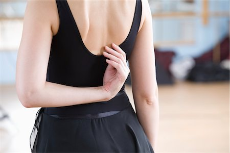 Young woman stretches in ballet rehearsal Stock Photo - Premium Royalty-Free, Code: 693-03317838