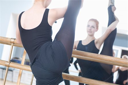 Young woman stretches into the splits Stock Photo - Premium Royalty-Free, Code: 693-03317848