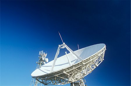 radio telescope - Telecommunications satellite dish and communications towers Stock Photo - Premium Royalty-Free, Code: 693-03310539