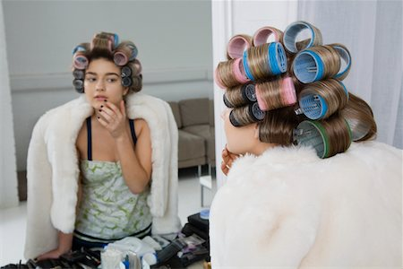 Model in Hair Curlers Looking at Reflection Stock Photo - Premium Royalty-Free, Code: 693-03313244