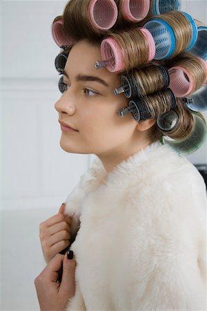 Model in Hair Curlers Wearing Fur Coat Stock Photo - Premium Royalty-Free, Code: 693-03313245