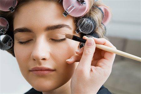 Model in Hair Curlers Having Makeup Applied Stock Photo - Premium Royalty-Free, Code: 693-03313248