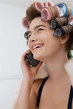 Model in Curlers Talking on Cell Phone Stock Photo - Premium Royalty-Free, Code: 693-03313242