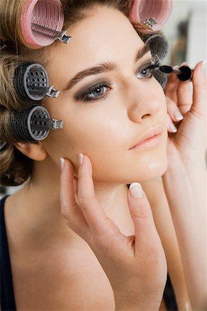 Model in Hair Curlers Having Makeup Applied Stock Photo - Premium Royalty-Free, Code: 693-03313258