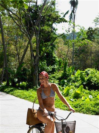 Young Woman Riding a Bike Stock Photo - Premium Royalty-Free, Code: 693-03313436