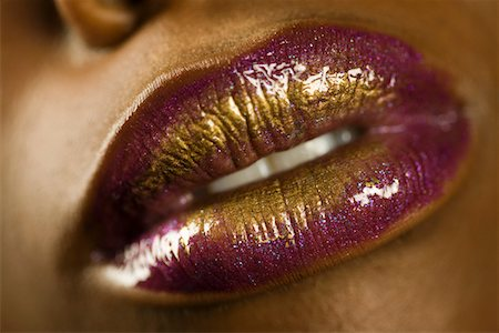 Young Woman with Purple and Gold Lipstick Stock Photo - Premium Royalty-Free, Code: 693-03313786
