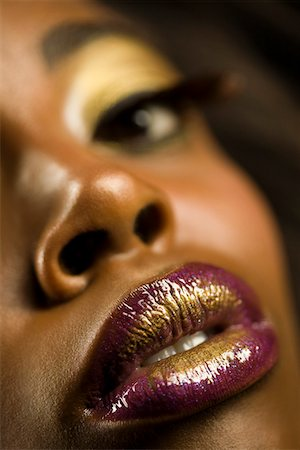 Young Woman with Purple and Gold Lipstick Stock Photo - Premium Royalty-Free, Code: 693-03313787