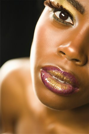 Closeup of Young Woman Stock Photo - Premium Royalty-Free, Code: 693-03313795