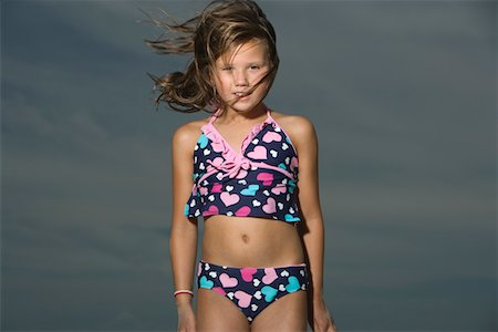 preteen girl swimsuit - Little Girl Standing on a Beach Stock Photo - Premium Royalty-Free, Code: 693-03313966