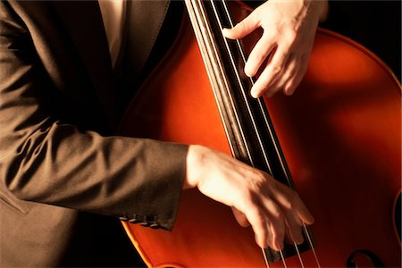 Hnads plucking fingerboard of double bass Stock Photo - Premium Royalty-Free, Code: 693-03440739