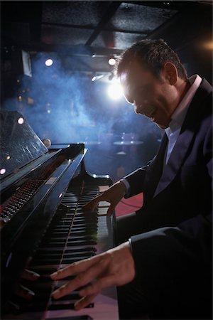 Pianist Performing in Jazz Club Stock Photo - Premium Royalty-Free, Code: 693-03440743