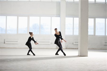 Woman and girl practise dance moves Stock Photo - Premium Royalty-Free, Code: 693-03474211