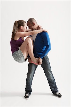 Man supports modern dance partner with barefeet Stock Photo - Premium Royalty-Free, Code: 693-03474510
