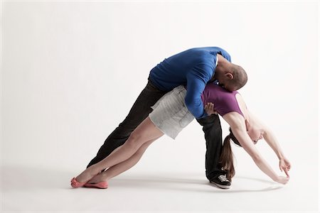 Man holds modern dance partner in position of loss Stock Photo - Premium Royalty-Free, Code: 693-03474511