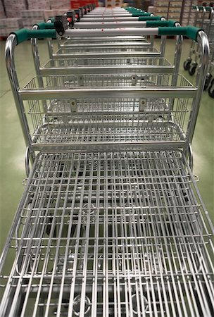 empty shopping cart - Empty Shopping Carts lined up in a row Stock Photo - Premium Royalty-Free, Code: 693-03557676