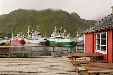 Fishing boats in harbour of Lofoten Islands, Norway Stock Photo - Premium Royalty-Free, Code: 693-03557828