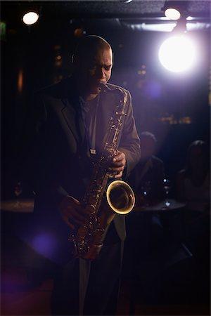 Saxophonist Playing Jazz Stock Photo - Premium Royalty-Free, Code: 693-03564997