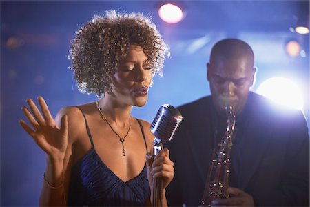 Jazz Singer and Saxophonist Performing Stock Photo - Premium Royalty-Free, Code: 693-03565002