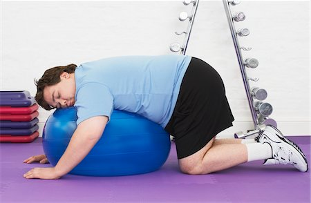 fat man exercising - Overweight Man sleeping on Exercise Ball in health club Stock Photo - Premium Royalty-Free, Code: 693-03565328