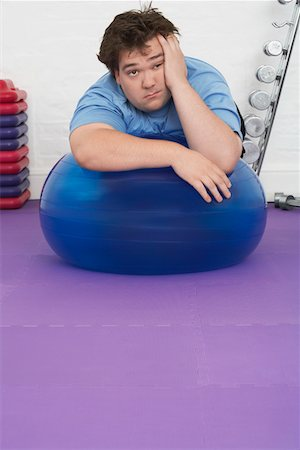 fat man exercising - Overweight Man Resting on Exercise Ball Stock Photo - Premium Royalty-Free, Code: 693-03565329