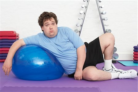fat man exercising - Overweight Man Doing Gymnastics Stock Photo - Premium Royalty-Free, Code: 693-03565339