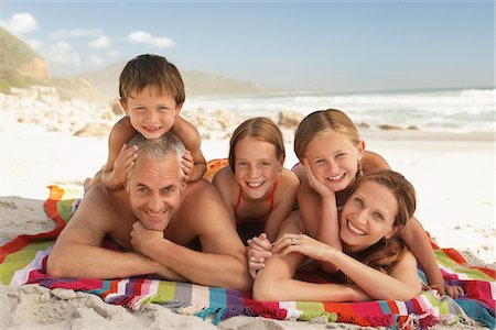 Family lying on beach. Stock Photo - Premium Royalty-Free, Code: 693-03617043