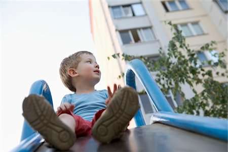 Young boy in playground Stock Photo - Premium Royalty-Free, Code: 693-03644039