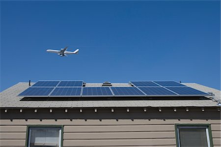 solar panel usa - Aeroplane and rooftop with solar array, Inglewood, Los Angeles, California Stock Photo - Premium Royalty-Free, Code: 693-03643977