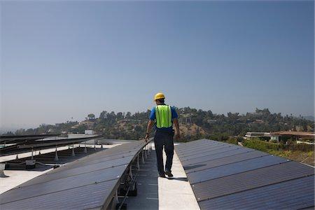 solar panel usa - Maintenance worker checks solar array on rooftop in Los Angeles, California Stock Photo - Premium Royalty-Free, Code: 693-03643971