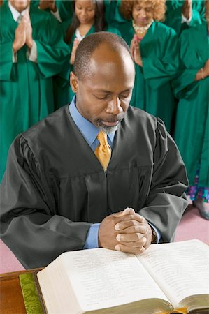 Preacher by altar in church Bowing Head in Prayer, high angle view Stock Photo - Premium Royalty-Free, Code: 693-03686347