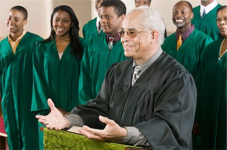 Minister Preaching in Front of Gospel Choir Stock Photo - Premium Royalty-Free, Code: 693-03686355