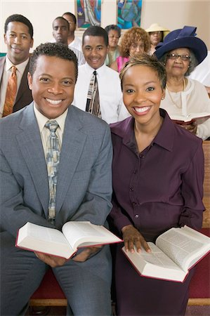 Young couple with Bibles sitting on church pews, portrait Stock Photo - Premium Royalty-Free, Code: 693-03686350