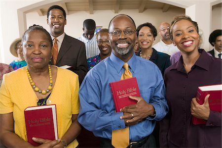 Sunday Service Congregation standing in church with Bibles, portrait Stock Photo - Premium Royalty-Free, Code: 693-03686351