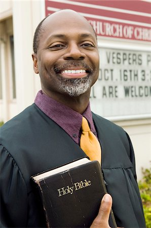 Smiling Preacher in Front of Church, portrait Stock Photo - Premium Royalty-Free, Code: 693-03686353