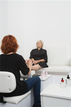 foot massage - Foot masseuse and client in Palm Springs salon Stock Photo - Premium Royalty-Free, Code: 693-03782574