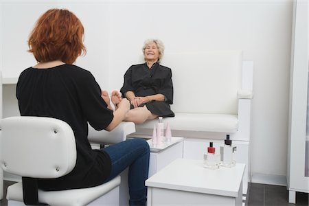 foot massage - Foot masseuse and client in Palm Springs salon Stock Photo - Premium Royalty-Free, Code: 693-03782573