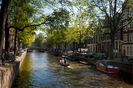 sun shine over canal with trees overhanging (Leliegracht) Stock Photo - Rights-Managed, Code: 700-04425165