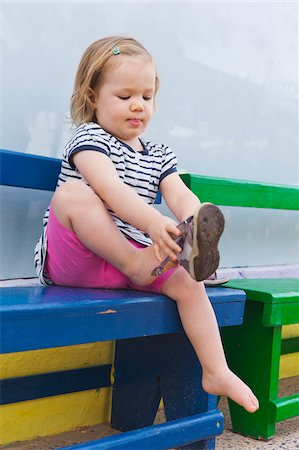 Little Girl Putting on Shoe Stock Photo - Rights-Managed, Code: 700-04926434