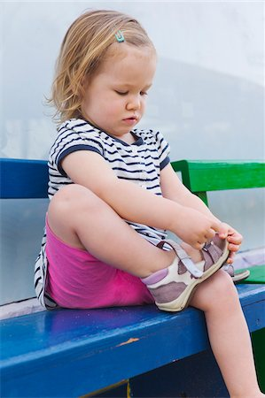 Little Girl Putting on Shoe Stock Photo - Rights-Managed, Code: 700-04926435