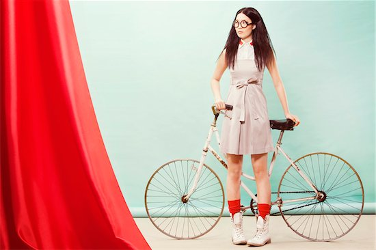 Portrait of Young Woman with Bicycle Stock Photo - Premium Rights-Managed, Artist: Siephoto, Image code: 700-04929230