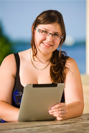 fat lady sitting - Portrait of Woman Using iPad Stock Photo - Rights-Managed, Code: 700-04929233