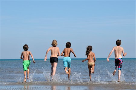 Kids Running into Water Stock Photo - Rights-Managed, Code: 700-04929254