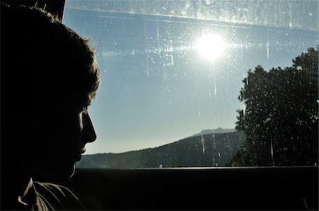 Boy Looking Out Car Window Stock Photo - Rights-Managed, Code: 700-04929259