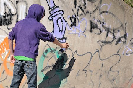 rear - Boy Spray Painting Graffiti Stock Photo - Rights-Managed, Code: 700-04929261