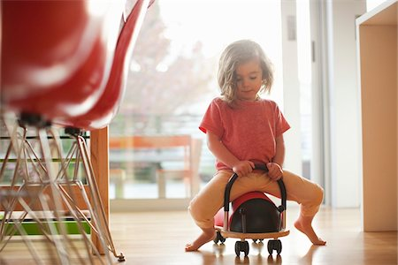 Little Girl Riding Ladybug Cart Stock Photo - Rights-Managed, Code: 700-04931664