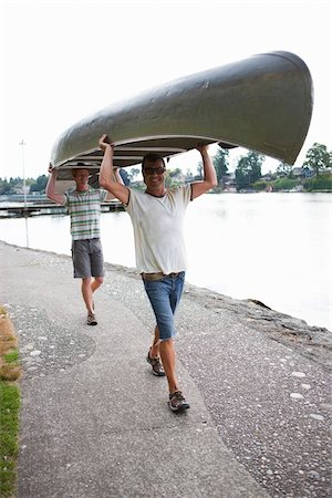 Two Men Carrying Canoe Stock Photo - Rights-Managed, Code: 700-04931673