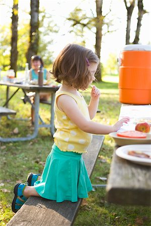 Little Girl Eating at Picnic Stock Photo - Rights-Managed, Code: 700-04931693