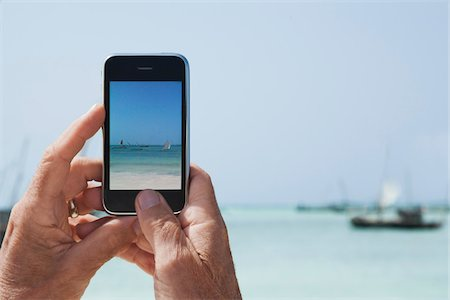 Taking Photos with iPhone Stock Photo - Rights-Managed, Code: 700-04981799