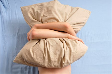 Boy Hugging Pillow in Bed Stock Photo - Rights-Managed, Code: 700-05181853